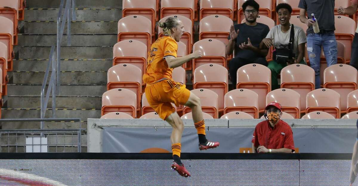 Houston Dynamo midfielder Griffin Dorsey (25) jumps in celebration after his goal against Austin FC during the first half of an MLS soccer match Saturday, Sept. 11, 2021, in Houston. (AP Photo/Michael Wyke)