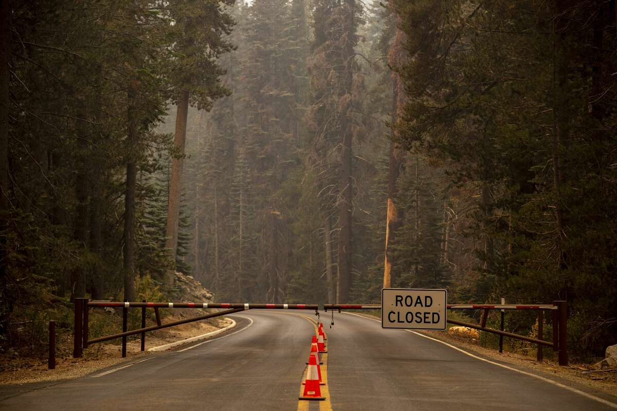 A gate is closed near the entrance to Sequoia National Park where the KNP Complex fire threatens groves of giants sequoias on Friday, Sept. 17, 2021.