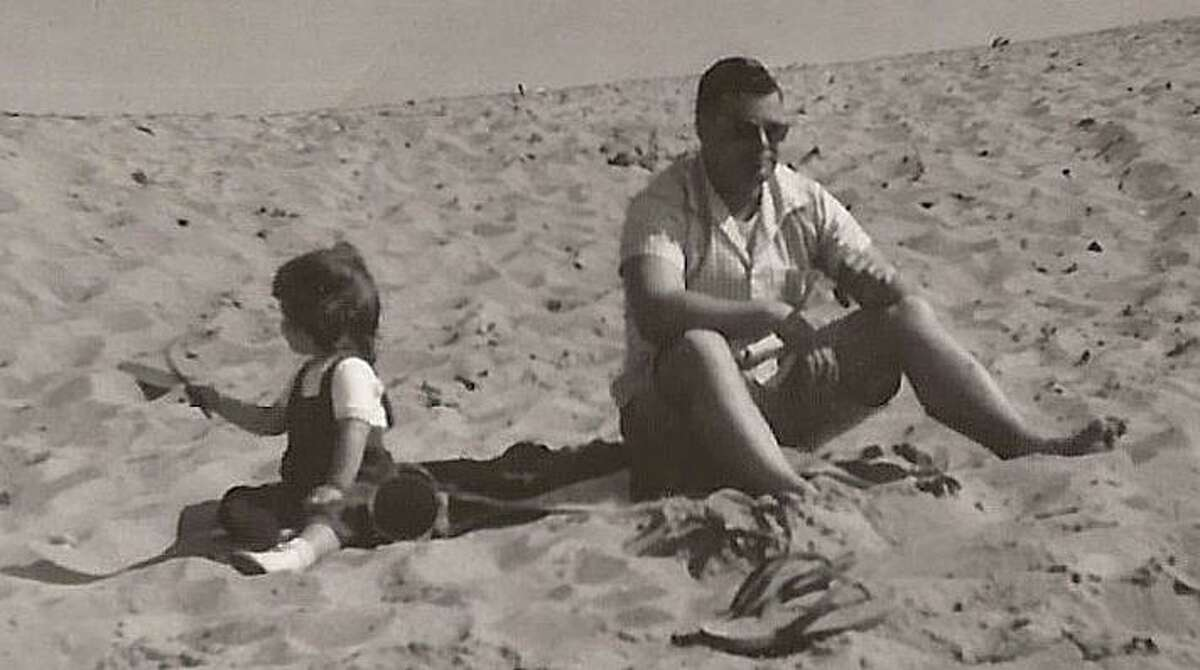 Columnist Susan Campbell as a toddler in the 1960s with her father on a California beach, where they spent Sunday mornings.