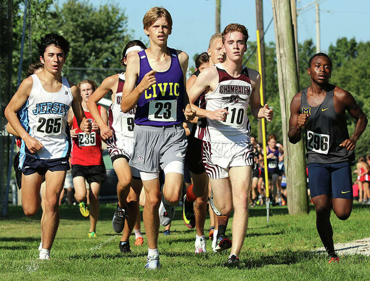 From left, Jersey's Cole Martinez, CM's Justice Eldridge, Champaign Central's Peter Smith and Marion's Benja Stone lead a pack of runner Saturday in the Highland Invite at Alhambra.