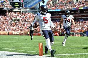 CLEVELAND, OHIO - SEPTEMBER 19: Quarterback Tyrod Taylor #5 of the Houston Texans runs the ball for a touchdown during the first half in the game against the Cleveland Browns at FirstEnergy Stadium on September 19, 2021 in Cleveland, Ohio.
