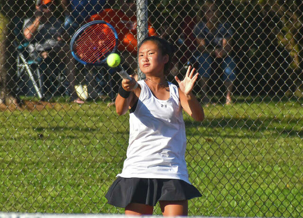 Edwardsville's Chloe Koons in action during a home match against Belleville East inside the EHS Tennis Center.