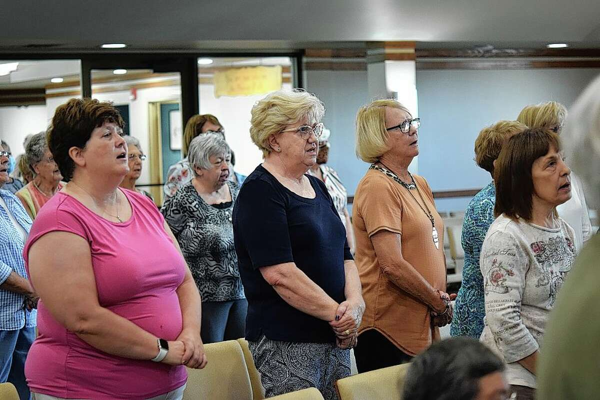 Explorers Bible Study participants sing a hymn before the lecture portion of the Tuesday morning class.