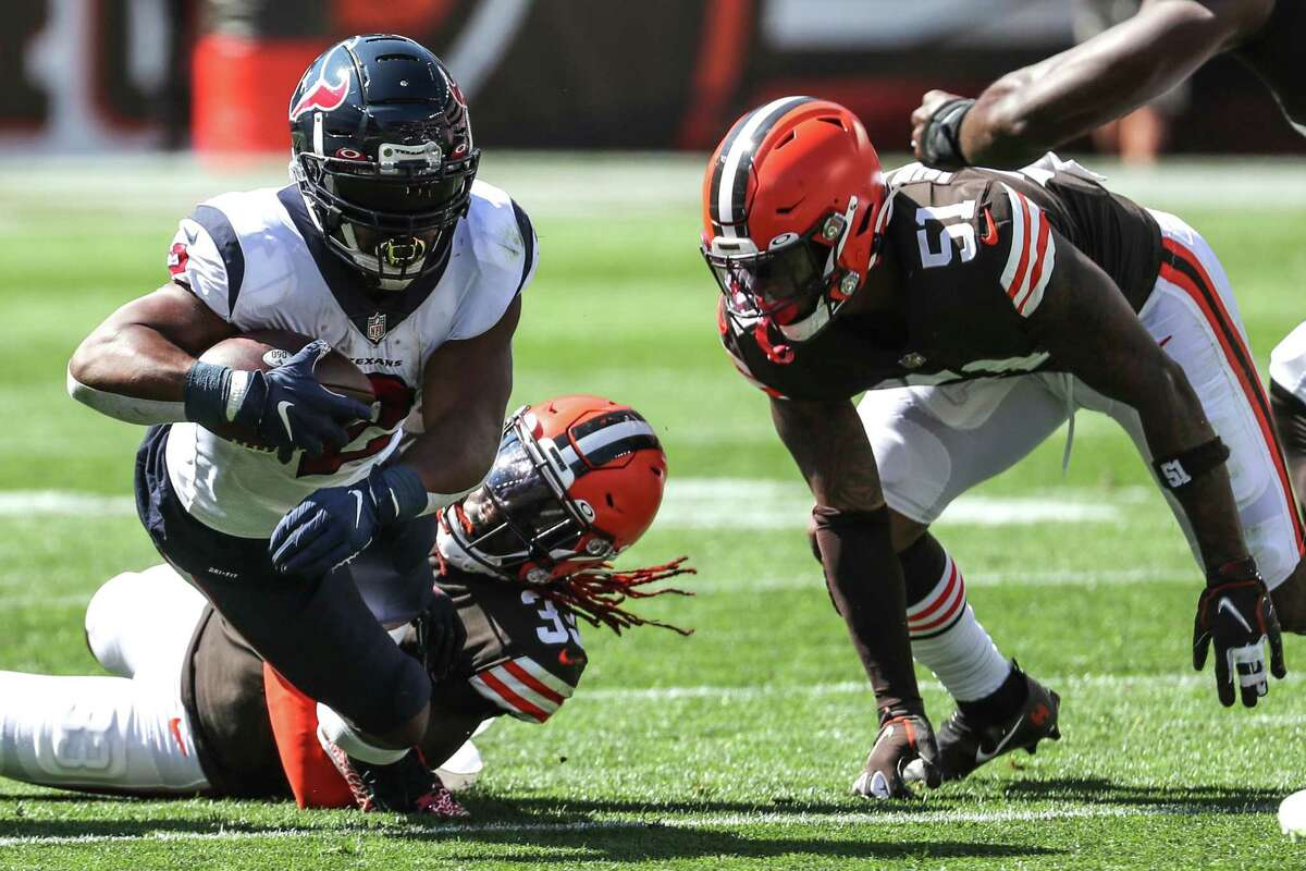 Houston Texans running back Mark Ingram II (2) is brought down by Cleveland Browns safety Richard LeCounte III during the first half of an NFL football game Sunday, Sept. 19, 2021, in Cleveland.