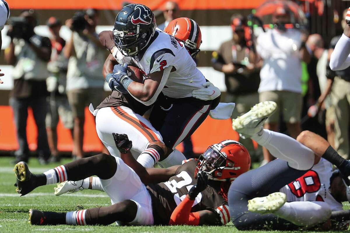 Houston Texans running back Mark Ingram II (2) runs the ball against the Cleveland Browns during the first half of an NFL football game Sunday, Sept. 19, 2021, in Cleveland.