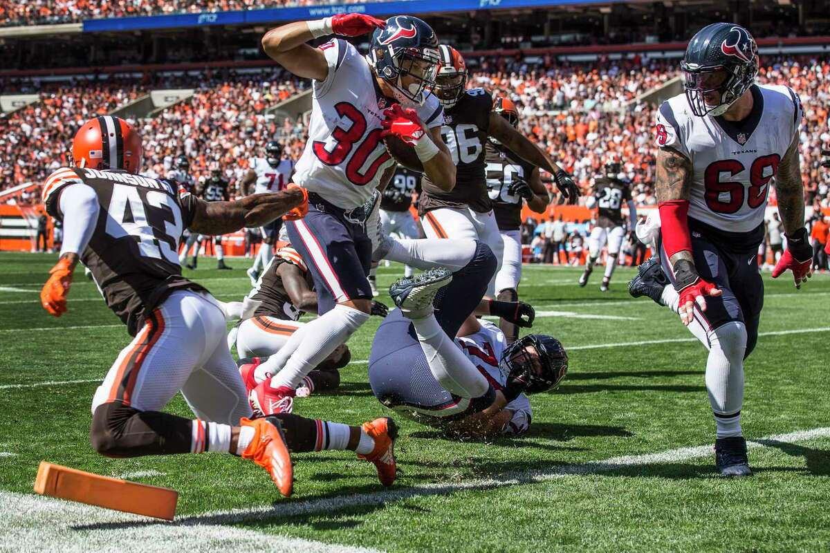 Houston Texans running back Phillip Lindsay (30) runs across the goal line for a 22-yard touchdown reception against the Cleveland Browns during the first half of an NFL football game Sunday, Sept. 19, 2021, in Cleveland.