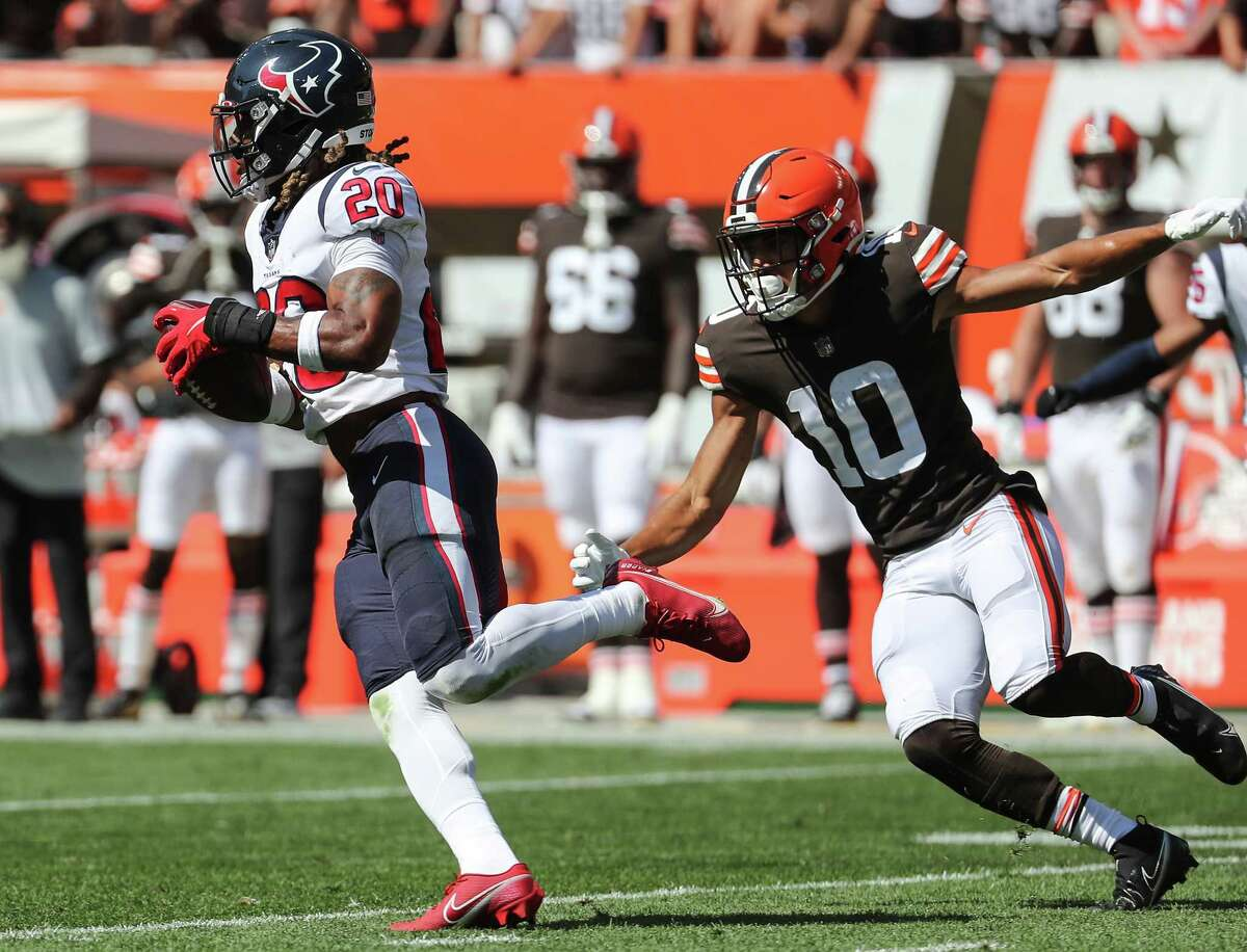 Houston Texans safety Justin Reid (20) jumps in front of Cleveland Browns wide receiver Anthony Schwartz (10) for an interception during the first half of an NFL football game Sunday, Sept. 19, 2021, in Cleveland.