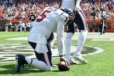 CLEVELAND, OHIO - SEPTEMBER 19: Quarterback Tyrod Taylor #5 of the Houston Texans kneels after scoring a touchdown during the first half in the game against the Cleveland Browns at FirstEnergy Stadium on September 19, 2021 in Cleveland, Ohio.