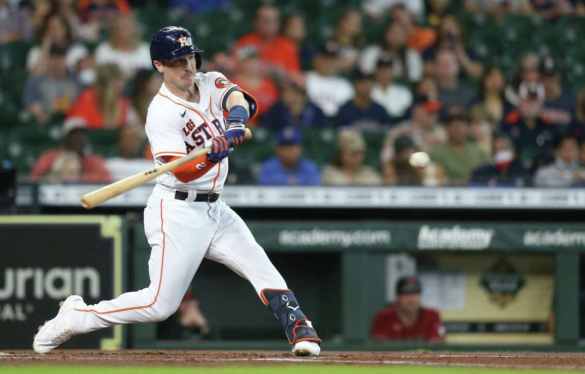 Houston Astros third baseman Alex Bregman (2) connects for a single in the first inning against the Arizona Diamondbacks at Minute Maid Park in Houston on Sunday, Sept. 19, 2021.