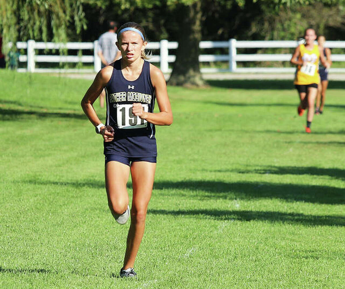 Father McGivney freshman Elena Rybak runs alone on the lead in the opening half of the three-mile girls race Saturday in the Highland Invite at Fireman and Legion Park in Alhambra. Rybak won the race by 29 seconds.