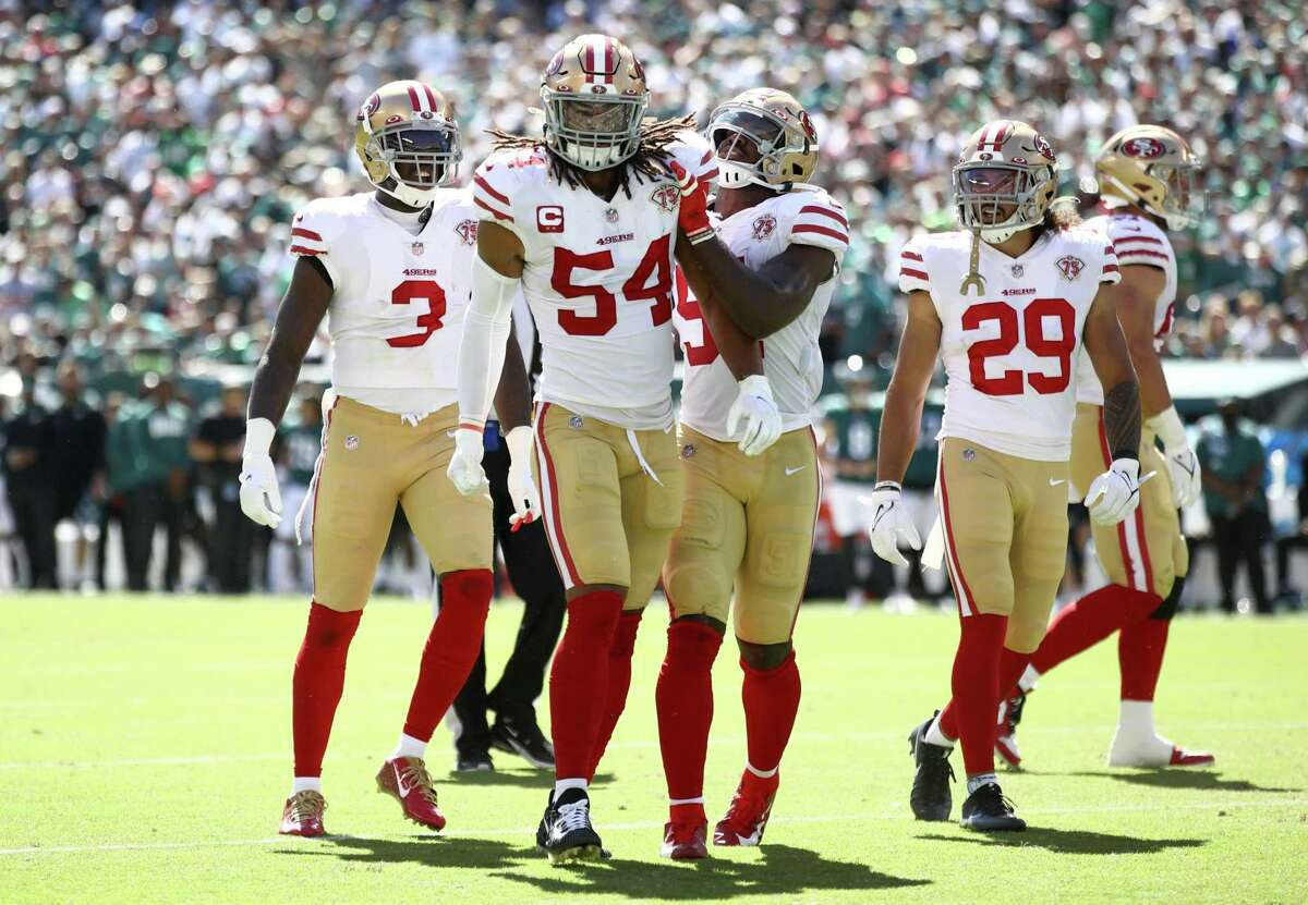 PHILADELPHIA, PENNSYLVANIA - SEPTEMBER 19: Middle linebacker Fred Warner #54 of the San Francisco 49ers celebrates with teammates after a defensive play in the game against the Philadelphia Eagles at Lincoln Financial Field on September 19, 2021 in Philadelphia, Pennsylvania. (Photo by Tim Nwachukwu/Getty Images)
