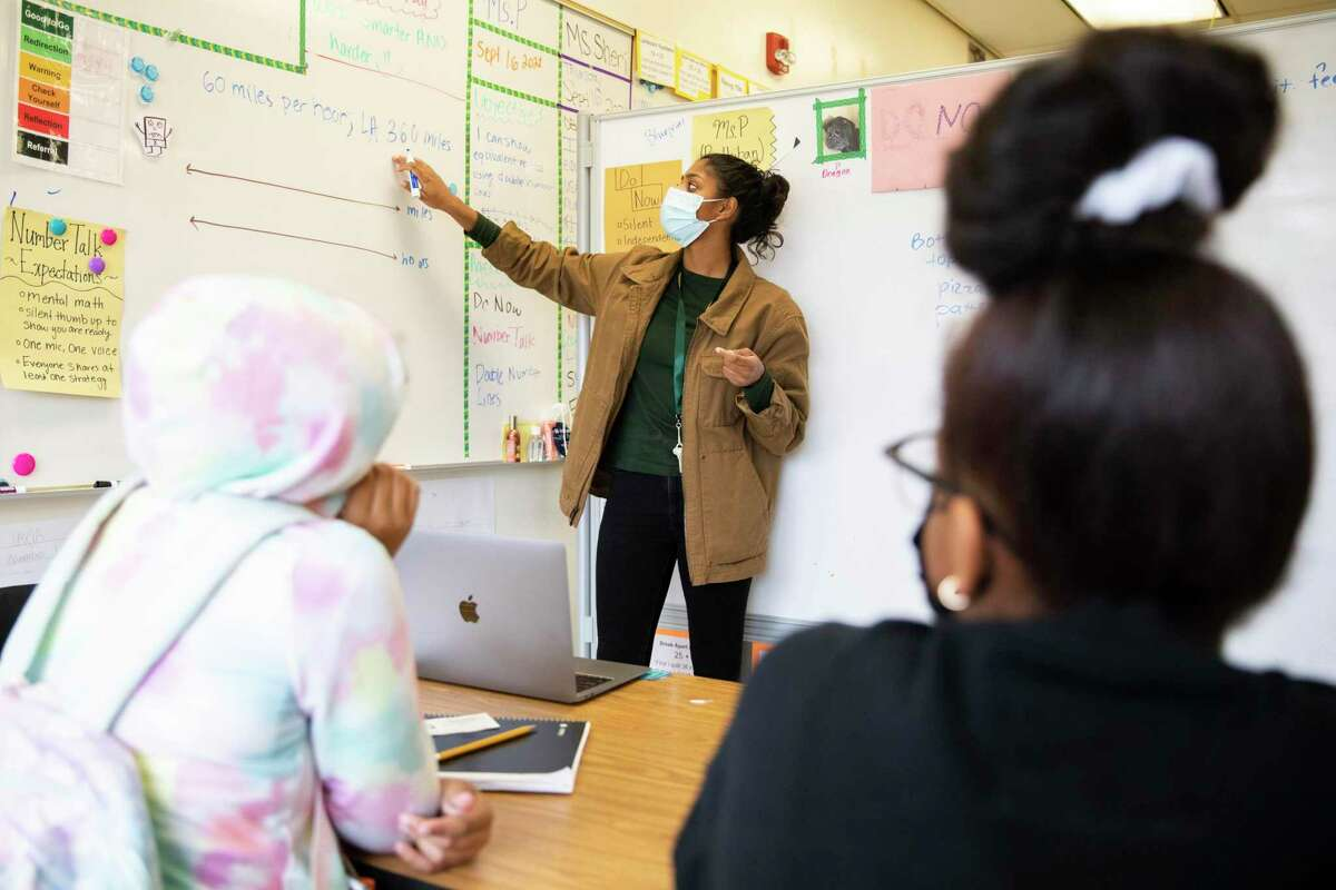 Shreya Parthiban teaches a BluePrint Math support class for seventh-graders at Westlake Middle School in Oakland. Westlake is using some of the funding it received for math classes for small groups of kids on the cusp of proficiency.