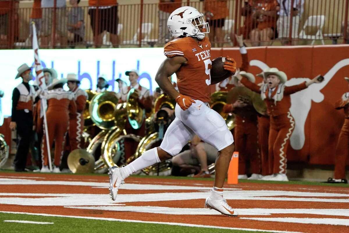 Texas running back Bijan Robinson (5) runs for a touchdown against Rice during the first half of an NCAA college football game on Saturday, Sept. 18, 2021, in Austin, Texas. (AP Photo/Chuck Burton)