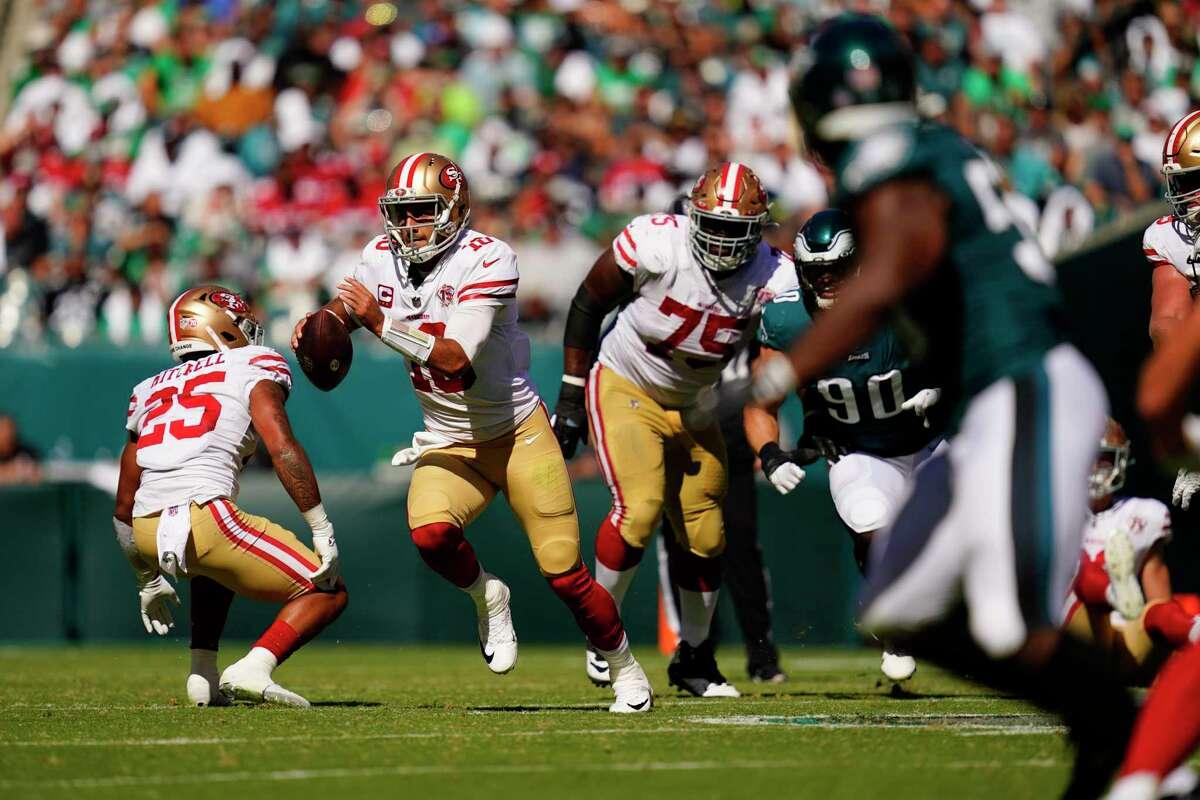 San Francisco 49ers quarterback Jimmy Garoppolo (10) runs with the ball during the second half of an NFL football game against the Philadelphia Eagles on Sunday, Sept. 19, 2021, in Philadelphia. (AP Photo/Matt Slocum)