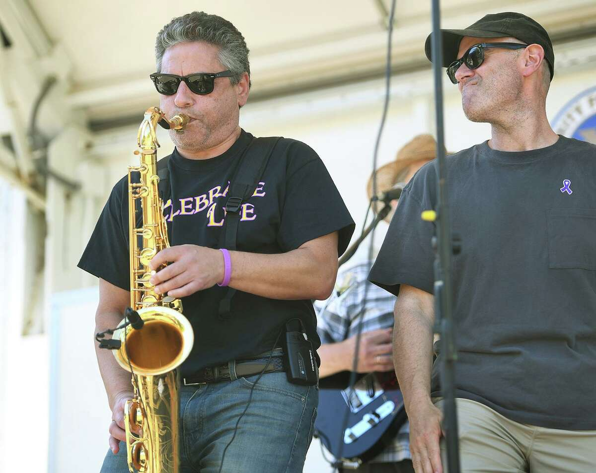 Dr. Richard Frank, left, performs with physician band DNR at the 4th Annual Rallye For Pancreatic Cancer at Riverview East in Norwalk, Conn. on Sunday, September 19, 2021.