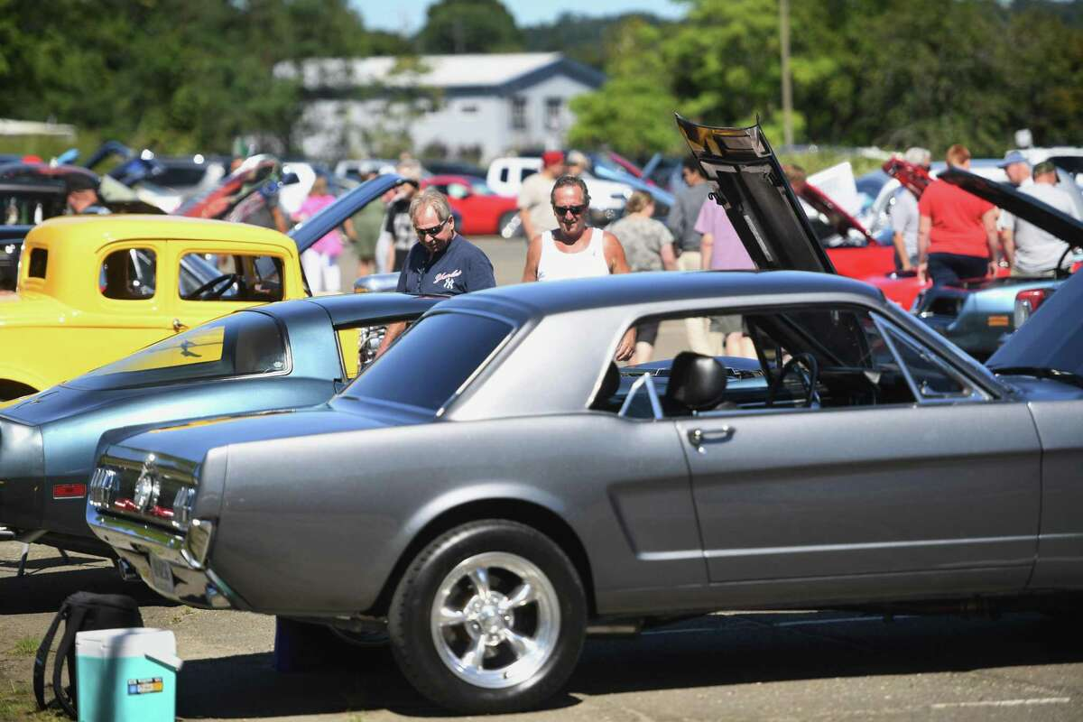 Enthusiasts check out the classic cars at the 4th Annual Rallye For Pancreatic Cancer car show at Riverview East in Norwalk, Conn. on Sunday, September 19, 2021.