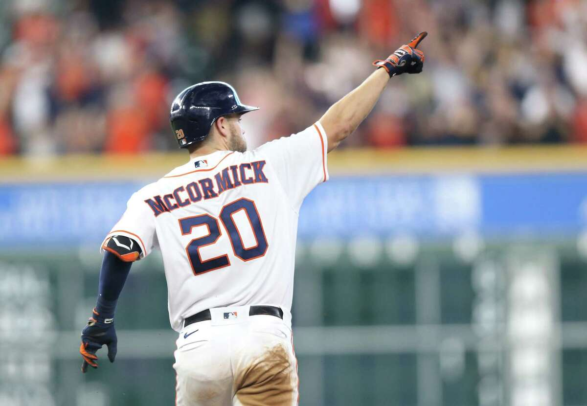 Houston Astros right fielder Chas McCormick (20) gestures as he rounds the bases after hitting a solo home run that gave the Astros a 7-6 lead over the Arizona Diamondbacks at Minute Maid Park in Houston on Sunday, Sept. 19, 2021.