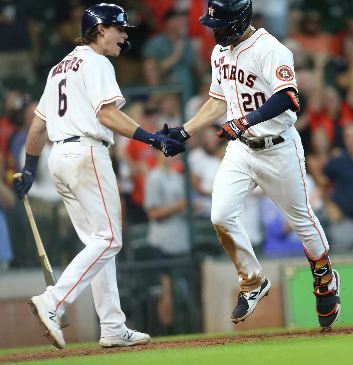 Houston Astros Jake Meyers (6) congratulates Chas McCormick (20) after's McCormick's solo home run in the bottom of the eighth inning against the Arizona Diamondbacks at Minute Maid Park in Houston on Sunday, Sept. 19, 2021.