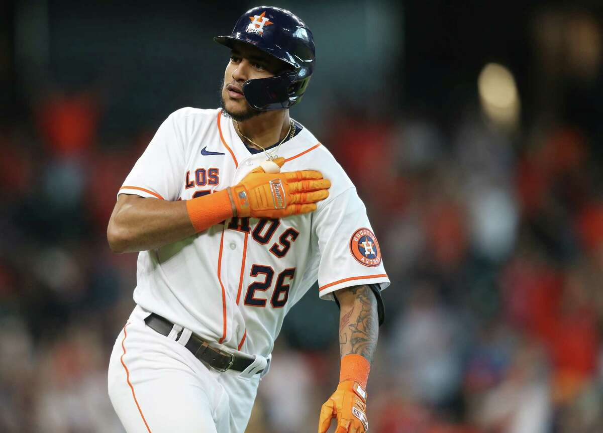 Houston Astros center fielder Jose Siri (26) gestures as he rounds the bases after hitting a two-run home run tying Arizona Diamondbacks in the bottom of the eighth inning at Minute Maid Park in Houston on Sunday, Sept. 19, 2021.