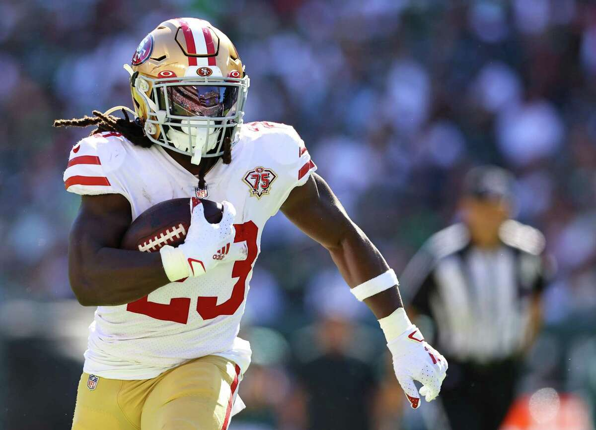 """Running back JaMycal Hasty carries the ball in the fourth quarter of Sunday's win over Philadephia. Hasty will be out """"a while"""" after sustaining a high ankle sprain, head coach Kyle Shanahan said Monday."""