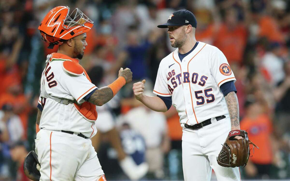 Astros catcher MartínMaldonado, left, guides a pitching staff that is a mix of veterans and youth and is beloved by his teammates.