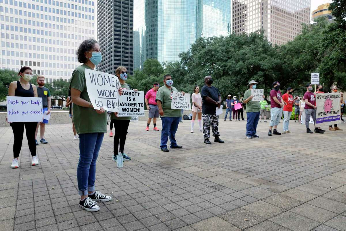 Demonstrators hold signs as they listens speakers during a protest of the recently passed Senate Bill 8 restricting abortion, held at Hermann Square on the steps of City Hall Sunday, Sept. 19, 2021 in Houston, TX.