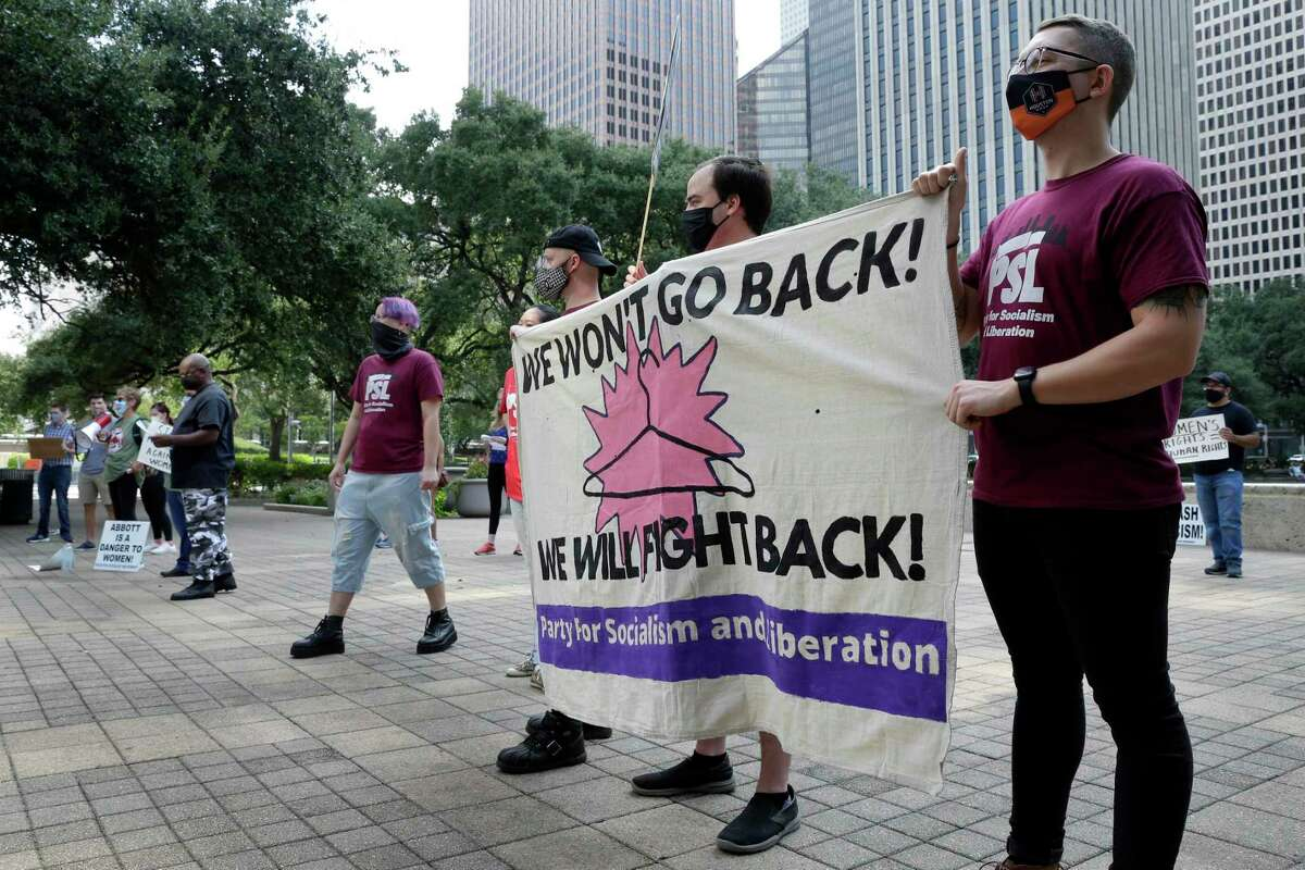 Members of the Party for Socialism and Liberation hold a banner along side some 50 others demonstrators during a protest of the recently passed Senate Bill 8 restricting abortion, held at Hermann Square on the steps of City Hall Sunday, Sept. 19, 2021 in Houston, TX.