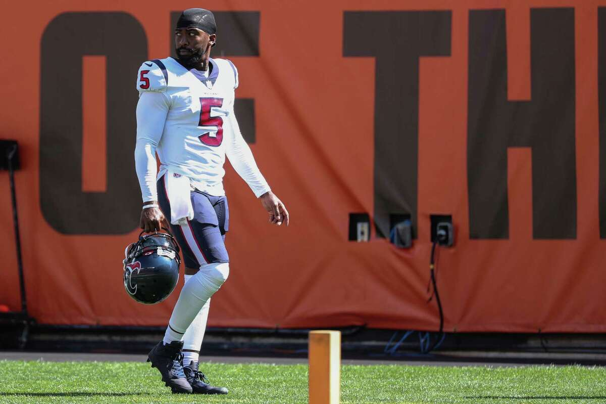 Houston Texans quarterback Tyrod Taylor (5) walks off the field at the end of the first half of an NFL football game Sunday, Sept. 19, 2021, in Cleveland. Taylor suffered an injury on his 15-yard touchdown run against the Cleveland Browns and did not return to the game in the second half.