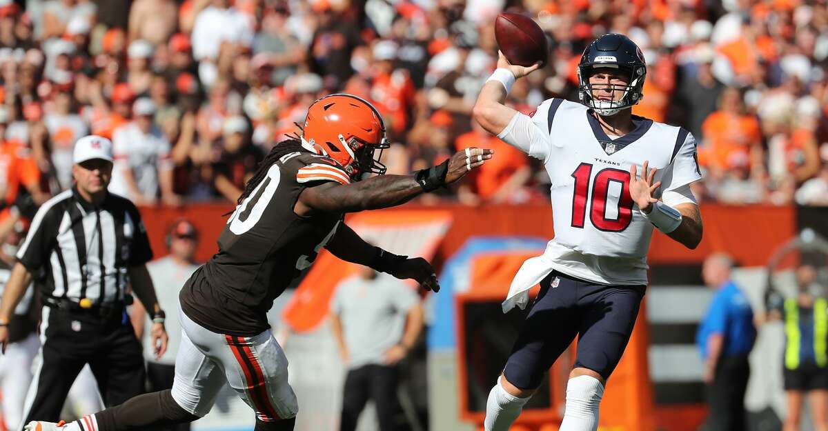 Cleveland Browns defensive end Jadeveon Clowney (90) pressures Houston Texans quarterback Davis Mills (10) as Mills throws an incomplete pass during the second half of an NFL football game Sunday, Sept. 19, 2021, in Cleveland.