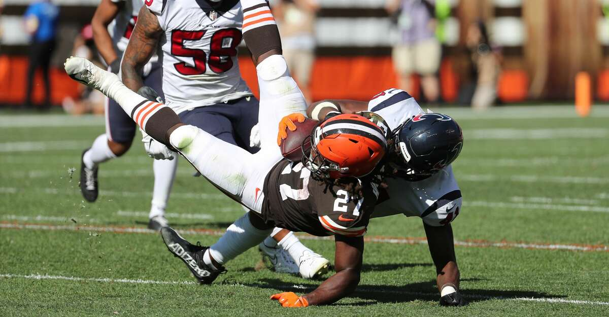Cleveland Browns running back Kareem Hunt (27) is brought down by Houston Texans linebacker Zach Cunningham (41) during the second half of an NFL football game Sunday, Sept. 19, 2021, in Cleveland.