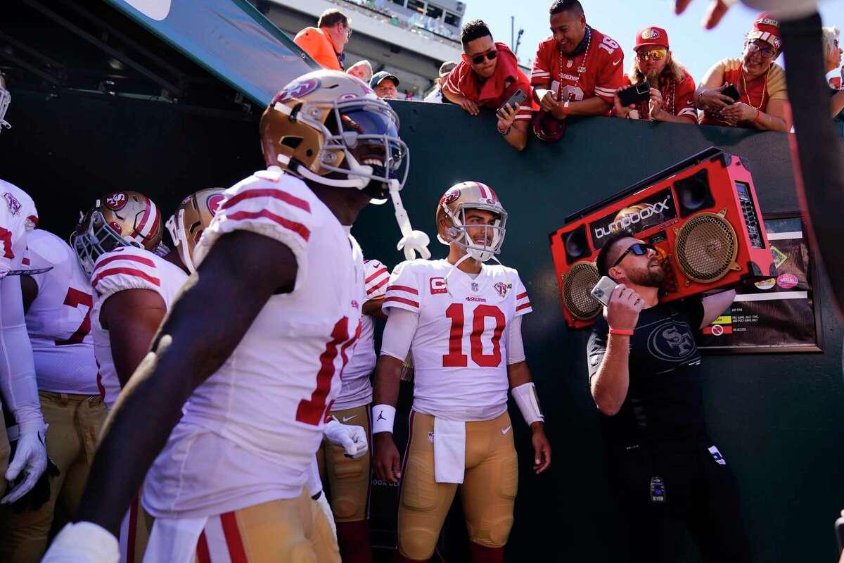 San Francisco 49ers quarterback Jimmy Garoppolo (10) prepares to run on the field before the first half of an NFL football game against the Philadelphia Eagles on Sunday, Sept. 19, 2021, in Philadelphia. (AP Photo/Matt Slocum)