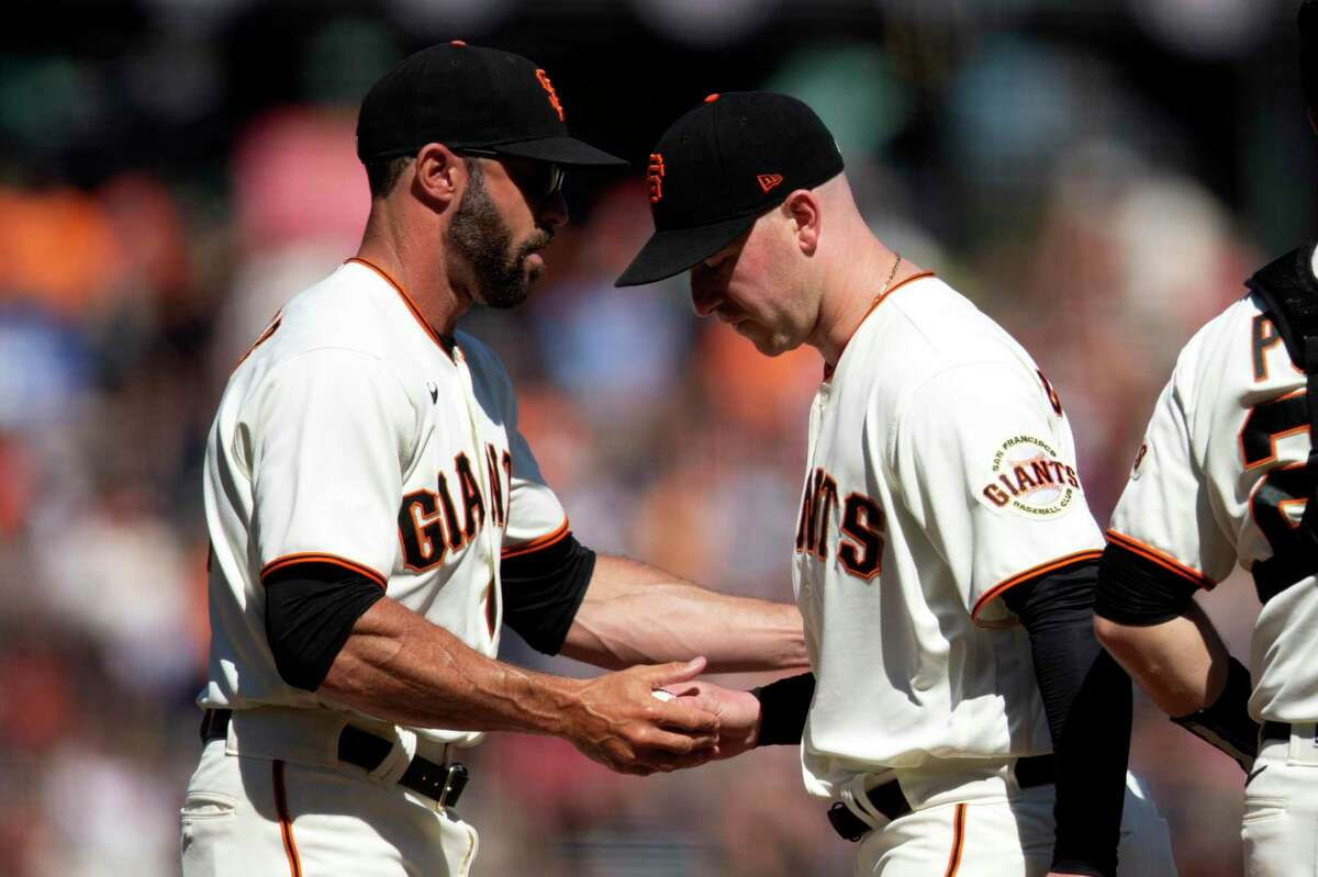 San Francisco manager Gabe Kapler (left) takes the ball from starting pitcher Anthony DeSclafani in the seventh inning.