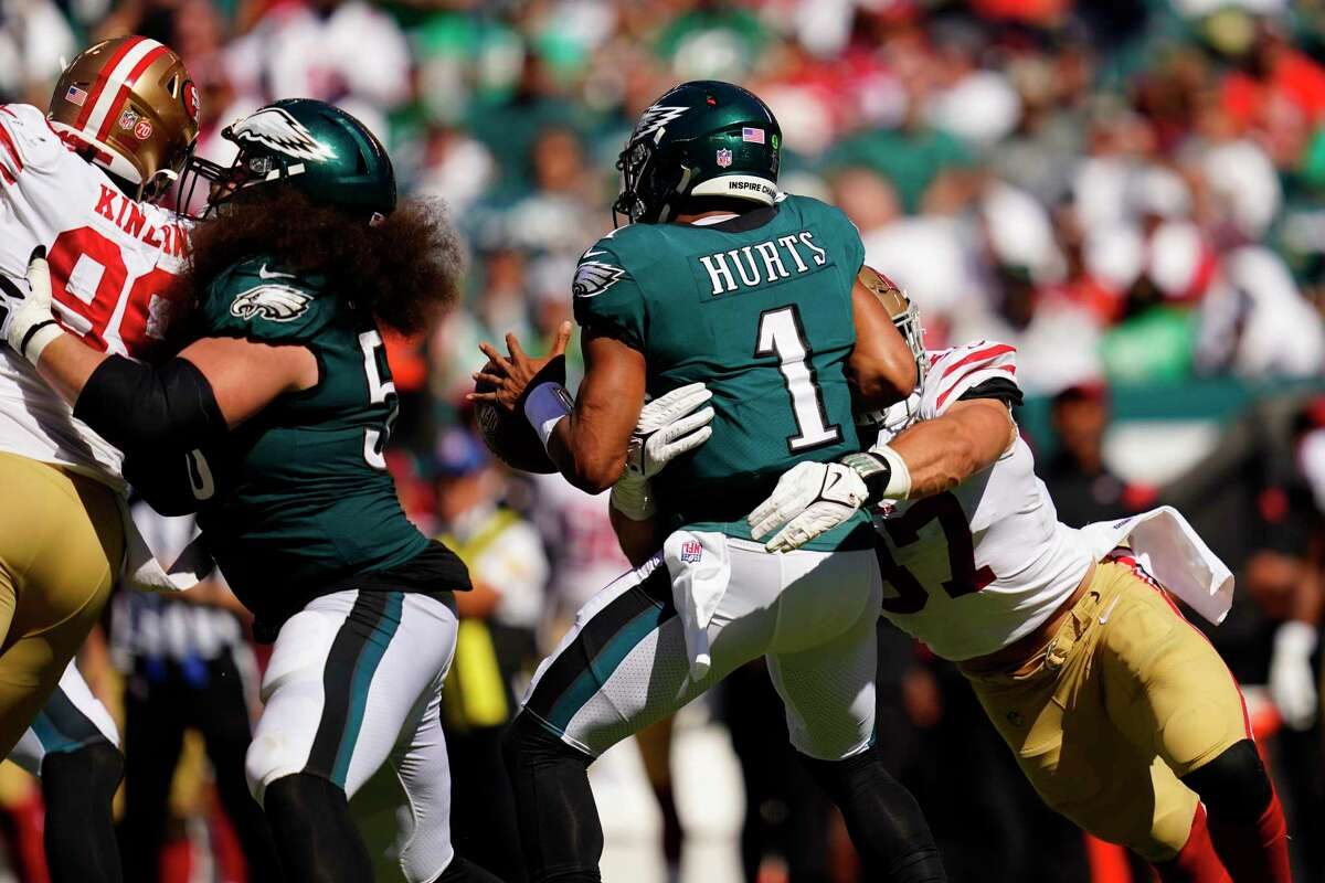 49ers defensive end Nick Bosa (97) sacks Eagles quarterback Jalen Hurts and forces a fumble in the third quarter.