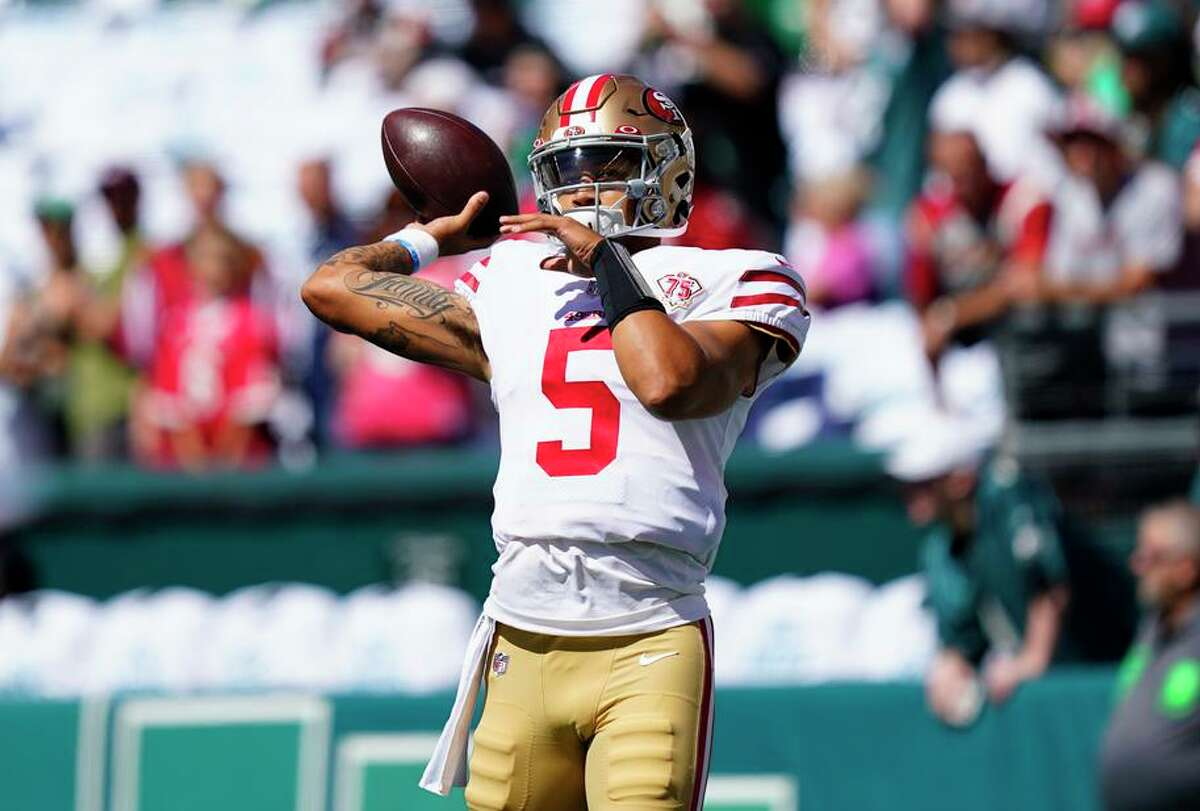 Quarterback Trey Lance warms up before the 49ers' game against the Eagles, but the rookie didn't play a down.