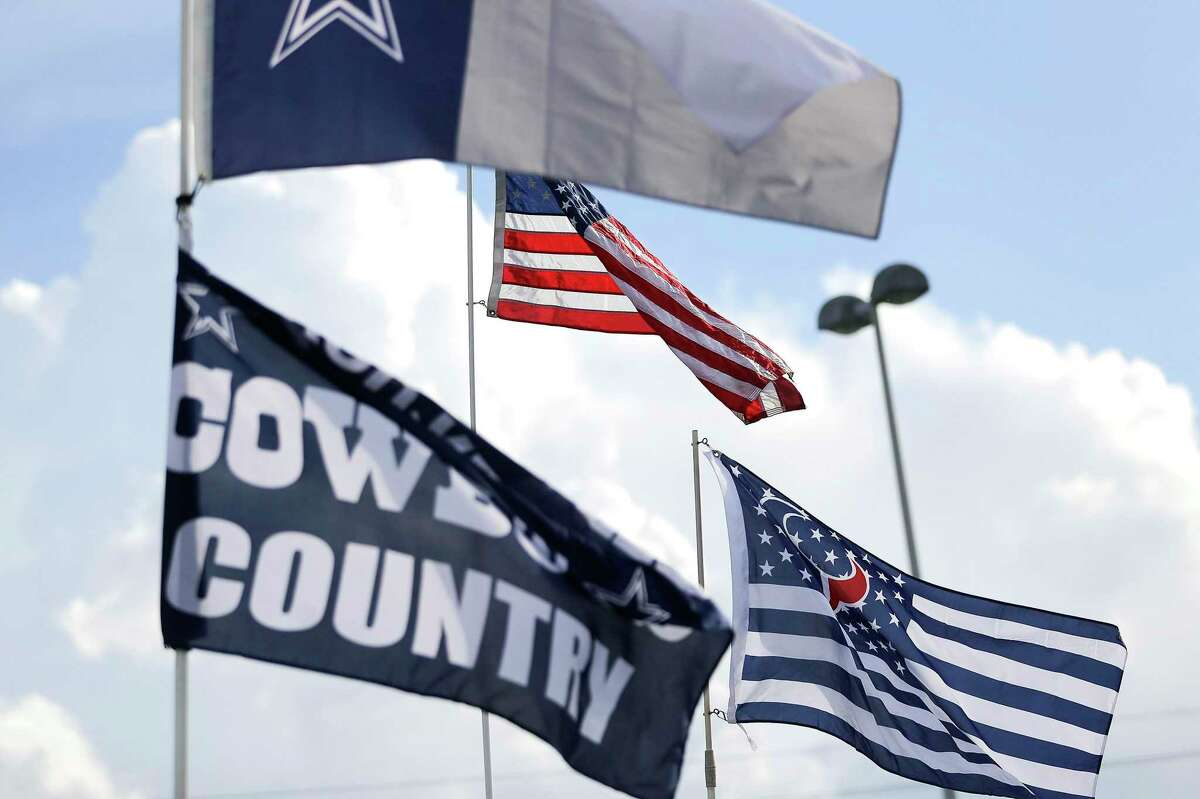 Fans tailgate before an NFL football between Dallas Cowboys and Houston Texans game at NRG Stadium on Sunday, Oct. 7, 2018, in Houston.