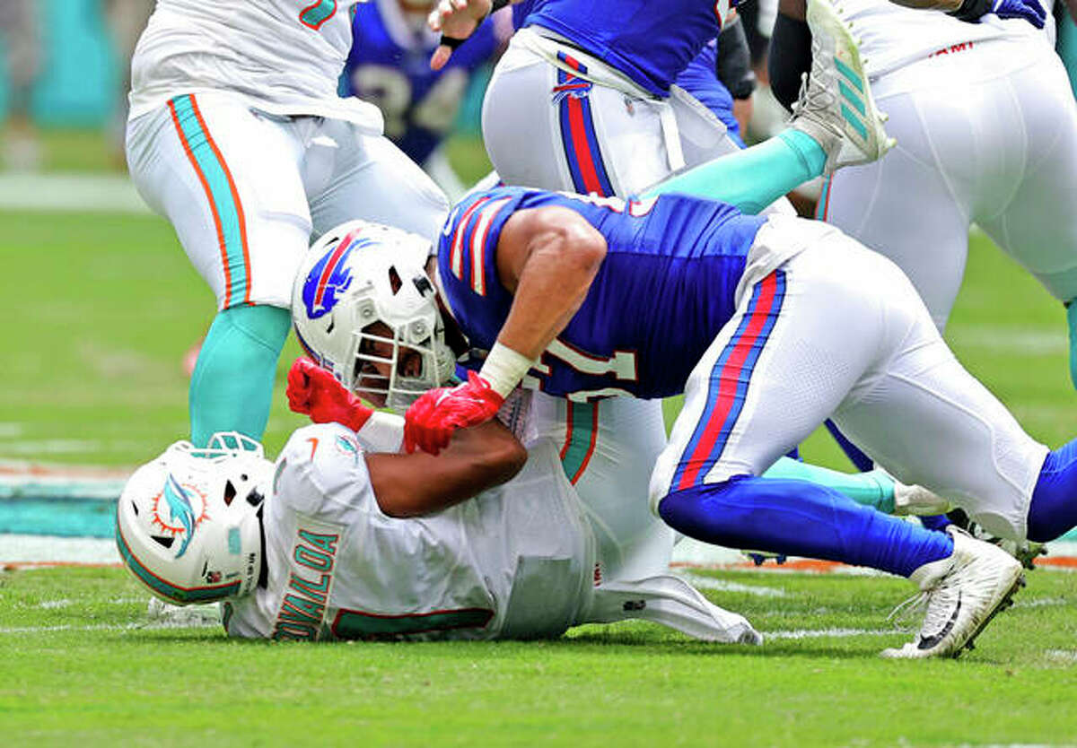 Miami Dolphins quarterback Tua Tagovailoa (1) is sacked by Buffalo Bills defensive end A.J. Epenesa (57) during first half of an NFL football game, Sunday, Sept. 19, 2021, in Miami Gardens, Fla. Tagovailoa was injured on the play.