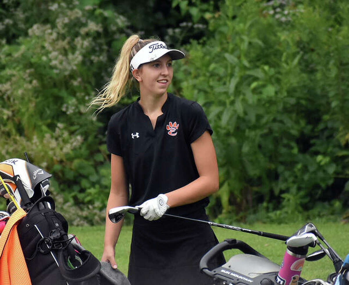 Edwardsville's Grace Daech reacts to her tee shot on No. 8 that landed two feet from the hole at Far Oaks Golf Club during the first round of the Southwestern Conference Tournament on Aug. 31 in Caseyville.