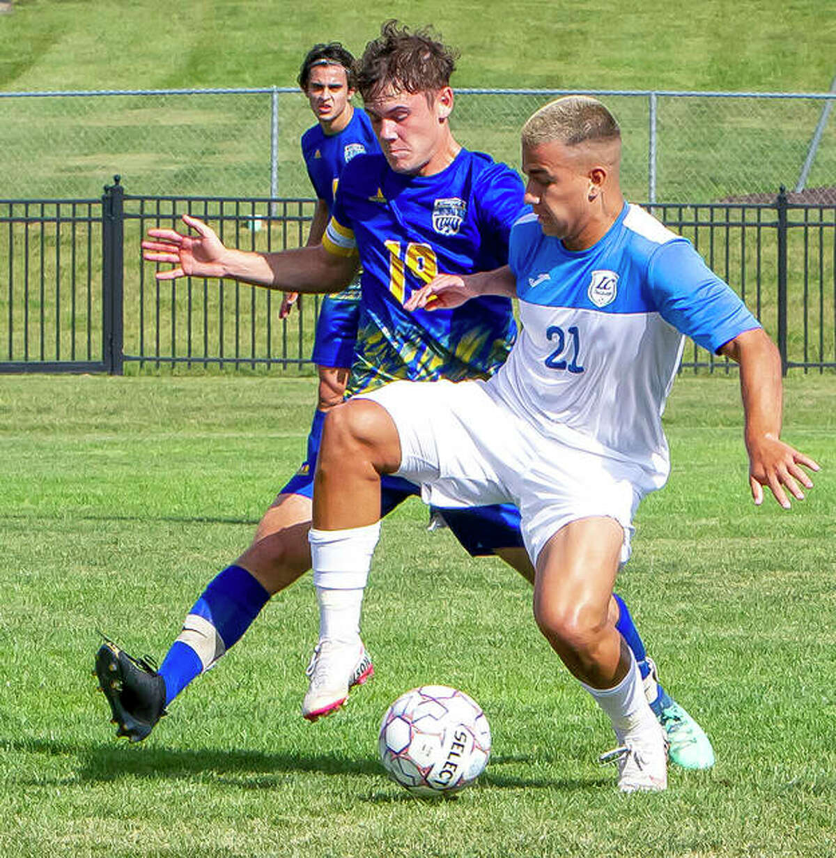 Lewis and Clark Community College's Dudu Rodrigues (21) battles for the ball with Logan Cupi of Illinois Central College Sunday at LCCC's Tim Rooney Stadium.