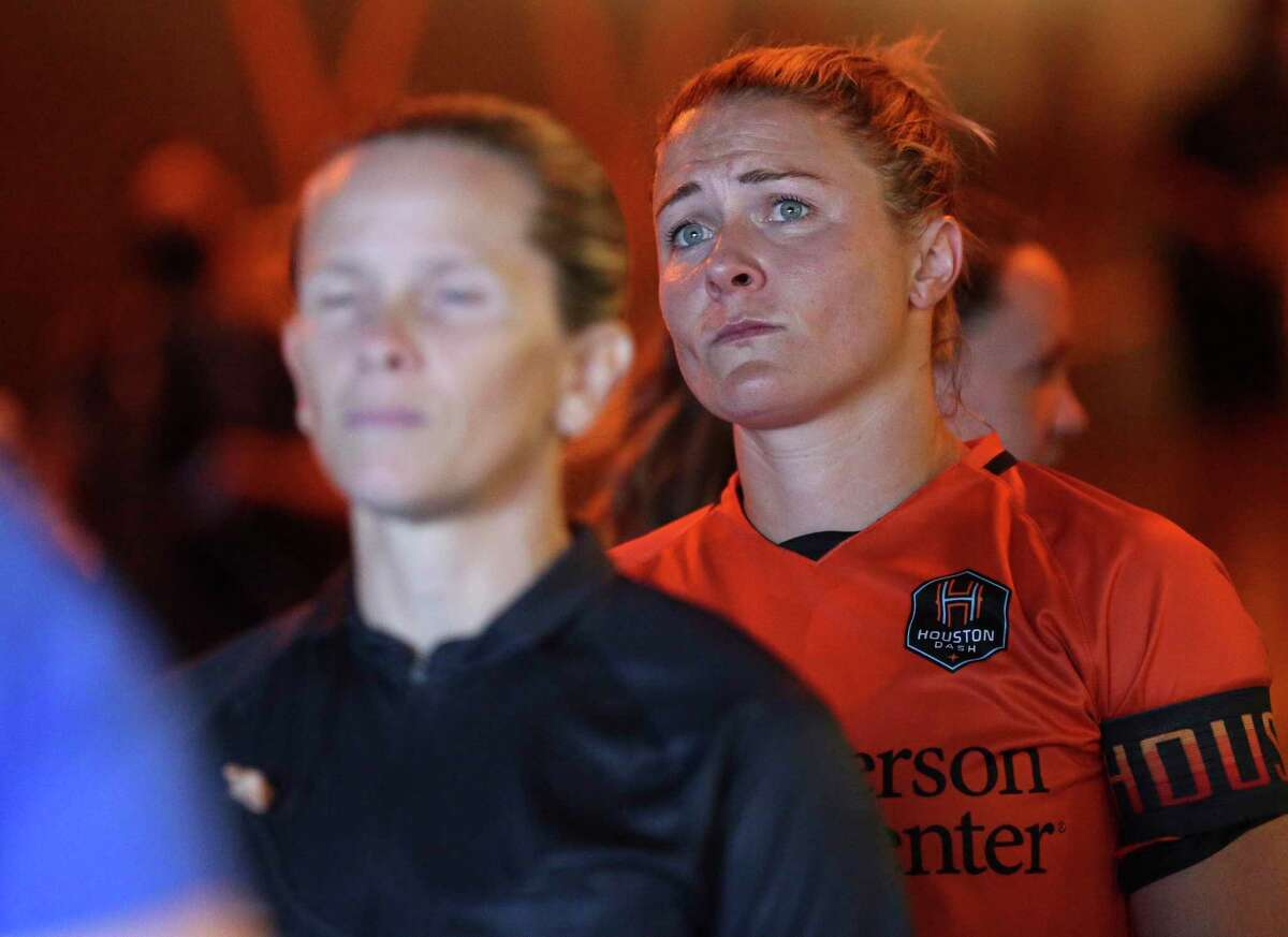 Houston Dash's Christine Nairn wears the captain arm band for her last game before retirement an international friendly match Sunday, Sept. 19, 2021, at BBVA Stadium in Houston. Nair is set to join Houston Fire Department Academy.