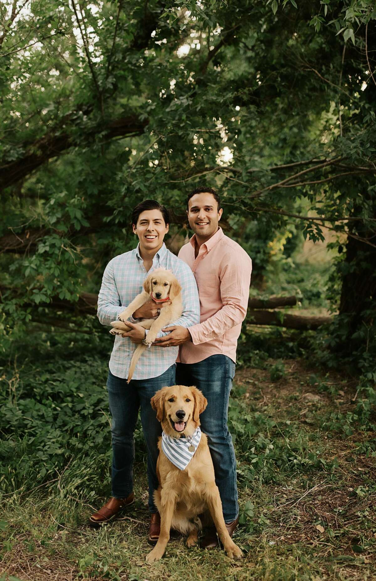 Alex (left) and Alexander (right) Mattey and their Golden Retrievers Lex and Lily
