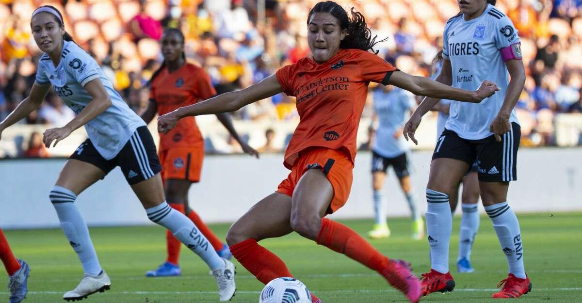 Houston Dash midfielder Makamae Gomera-Stevens (33) scores on Tigres Femenil during the first half of an international friendly match Sunday, Sept. 19, 2021, at BBVA Stadium in Houston.