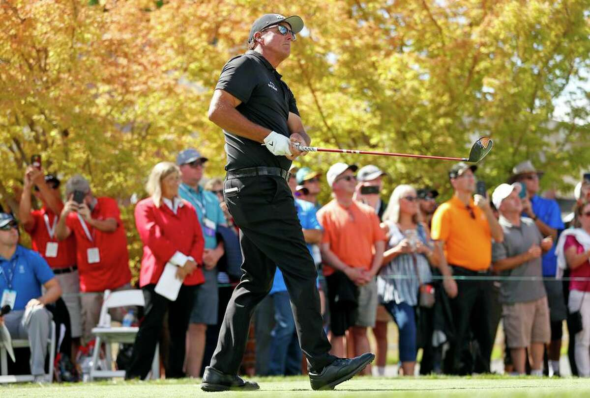Phil Mickelson watches his tee shot on the first hole during the final round. He shot 75 to fall into a tie for 36th at 7-under.