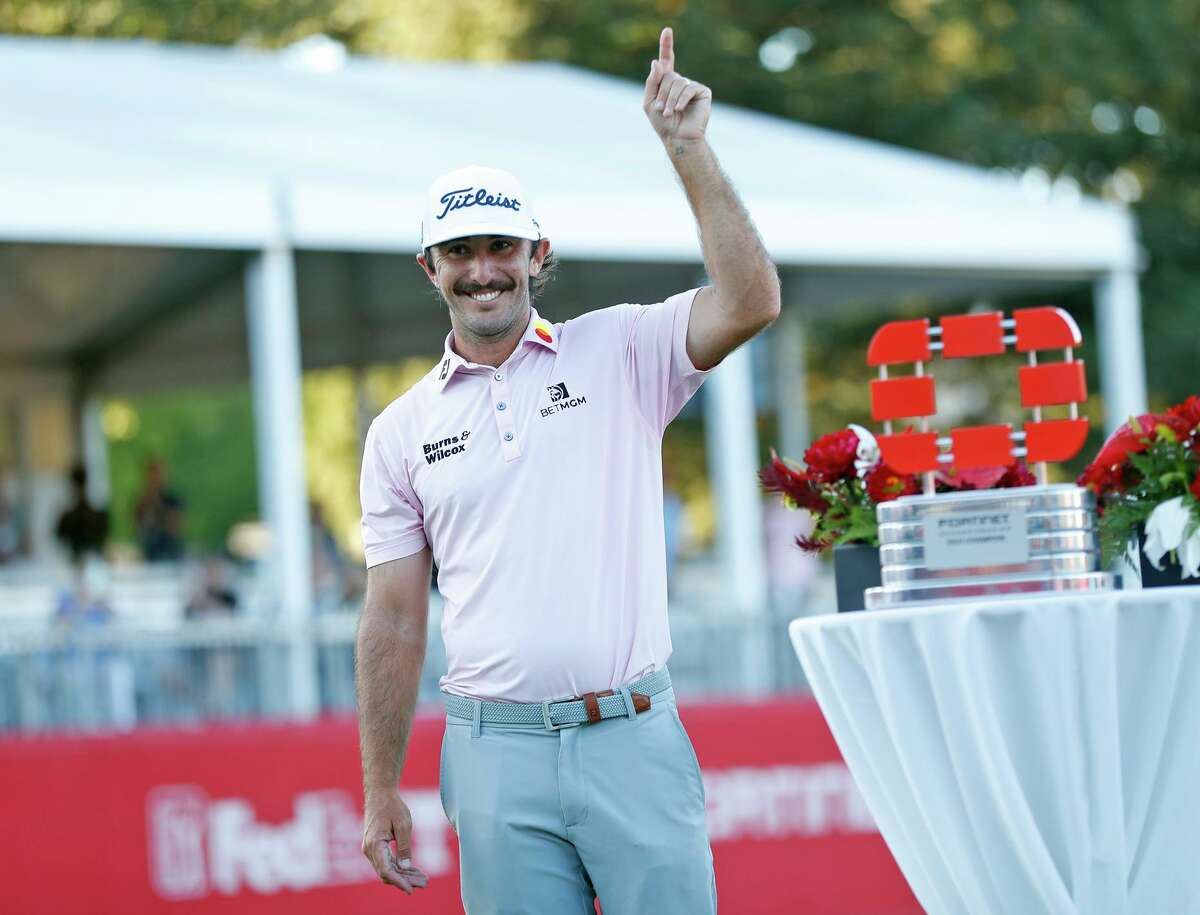 Max Homa celebrates next to the trophy after defeating Maverick McNealy by one stroke at Silverado Resort in Napa.