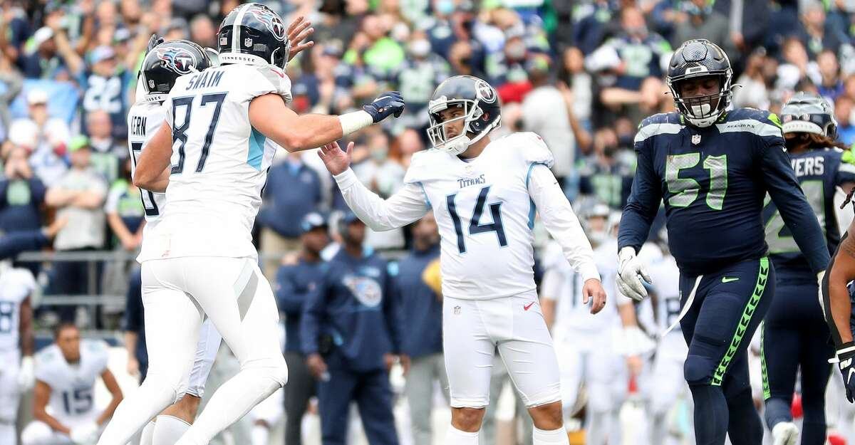 Randy Bullock #14 of the Tennessee Titans celebrates his game-winning field goal in overtime against the Seattle Seahawks at Lumen Field on September 19, 2021 in Seattle, Washington. (Photo by Steph Chambers/Getty Images)