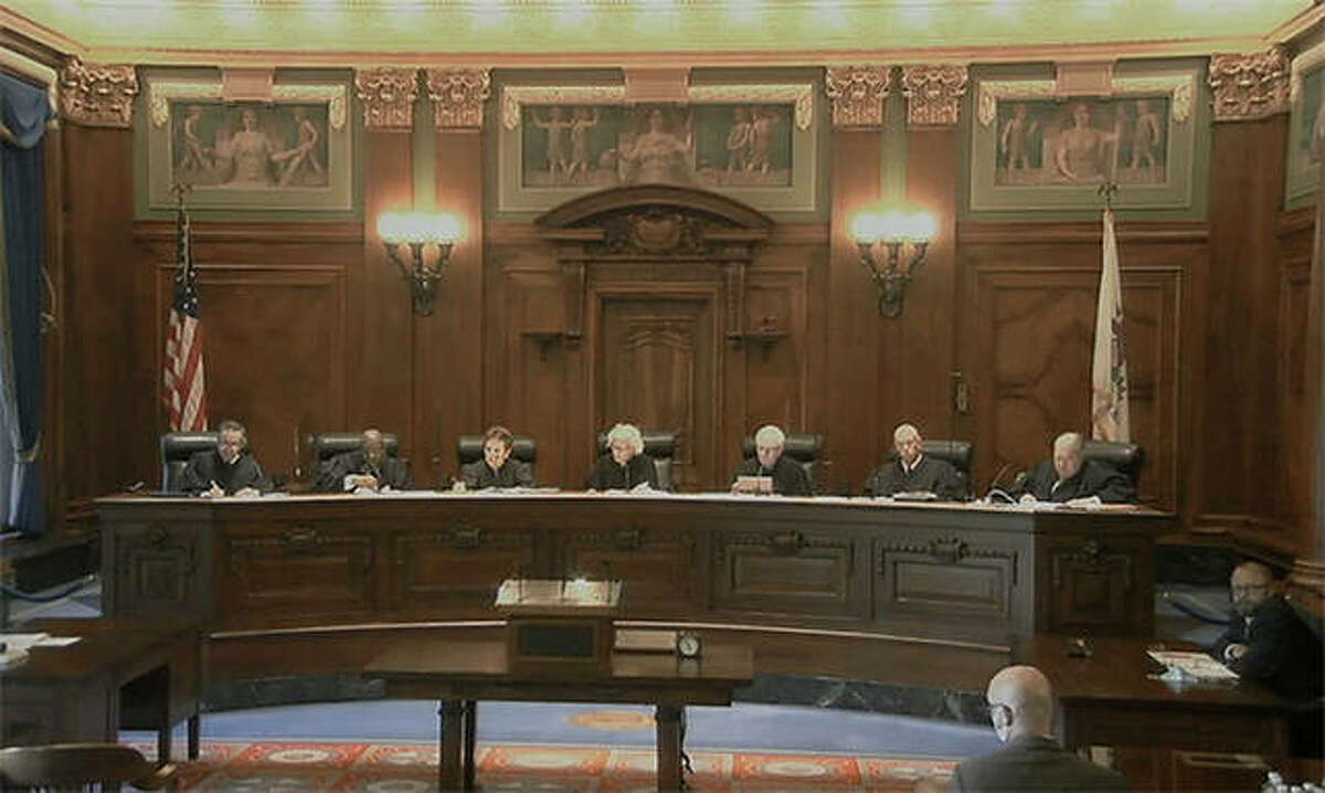 Members of the Illinois Supreme Court hear oral arguments in Springfield.