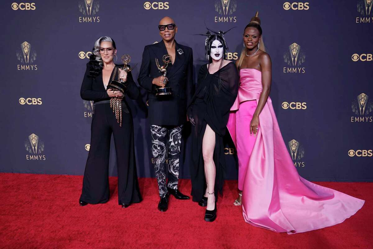 """Michelle Visage, from left, RuPaul Charles, Gottmik, and Symone pose for a photo with the award for outstanding competition program for """"RuPaul's Drag Race"""" at the 73rd Primetime Emmy Awards on Sunday, Sept. 19, 2021, at L.A. Live in Los Angeles."""