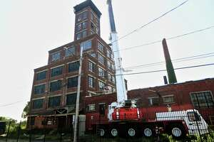 Work continues on the shot tower on Arctic Street on the East Side of Bridgeport, Conn. on Monday, September 13, 2021.