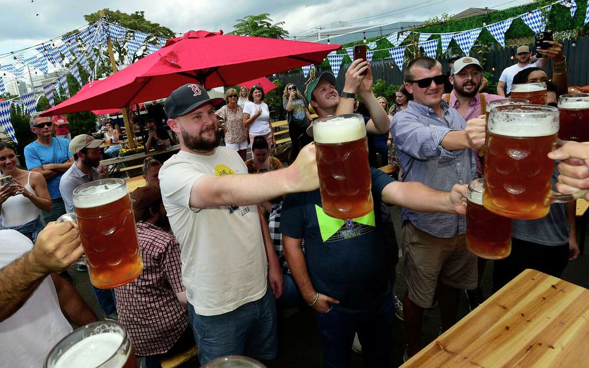 Contestants including Drew Gabelis of Stamford compete in a steinholding competition at Third Place Saturday, September 18, 2021, in Stamford. Third Place by Half Full Brewery is kicking off their Oktoberfest celebrations this weekend with the steinholding competition.