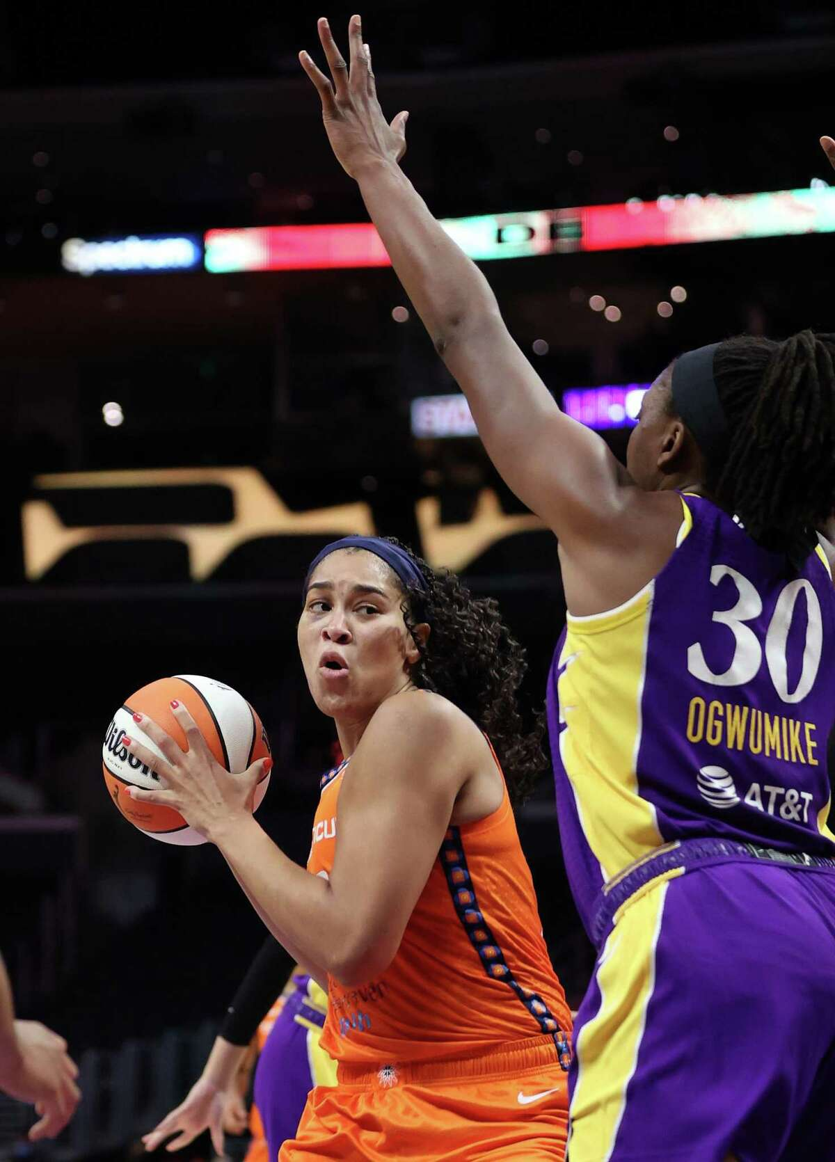 The Sun's Brionna Jones controls the ball against the Sparks' Nneka Ogwumike on Sept. 9 in Los Angeles.