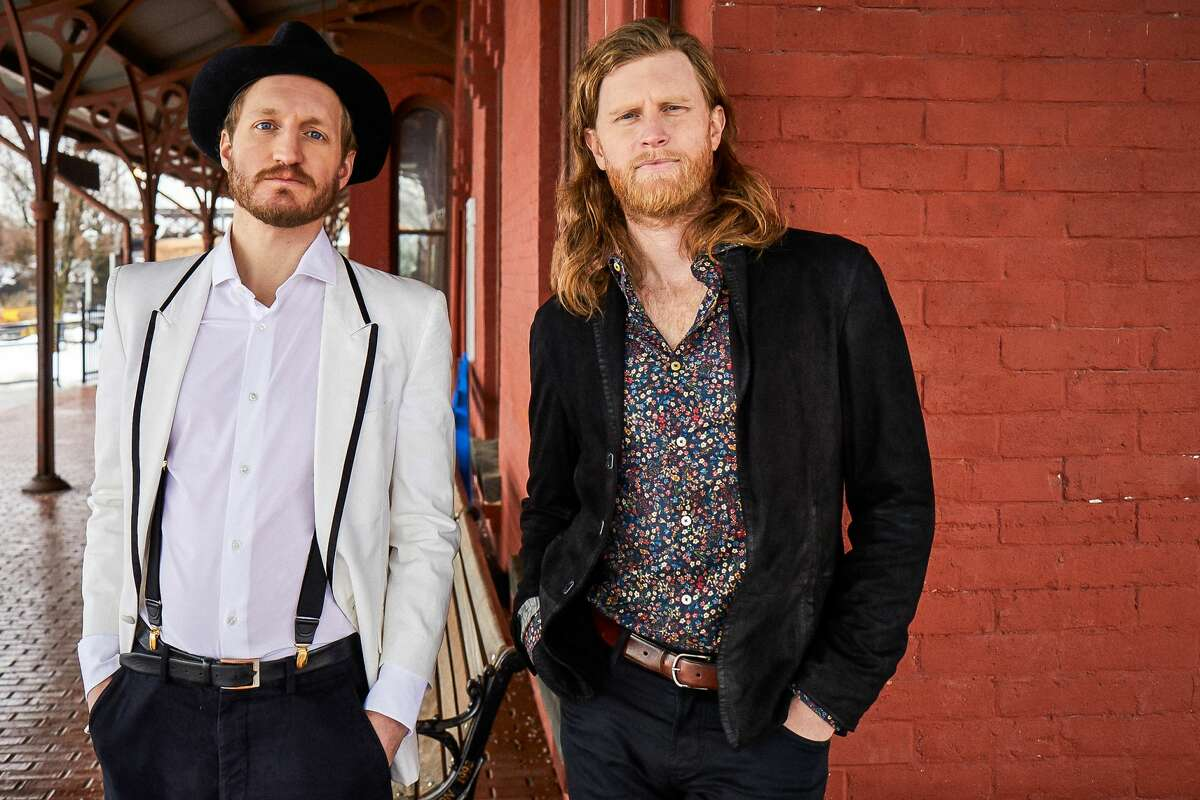 The Lumineers' current, founding members, Jeremiah Fraites (left) and Wesley Schultz, photographed at the Hudson Amtrak station, have recorded three straight albums in the region. Their newest was produced by Ulster County resident Simone Felice, formerly of the band the Felice Brothers, and David Baron, owner of Sun Mountain Studios in Boiceville.